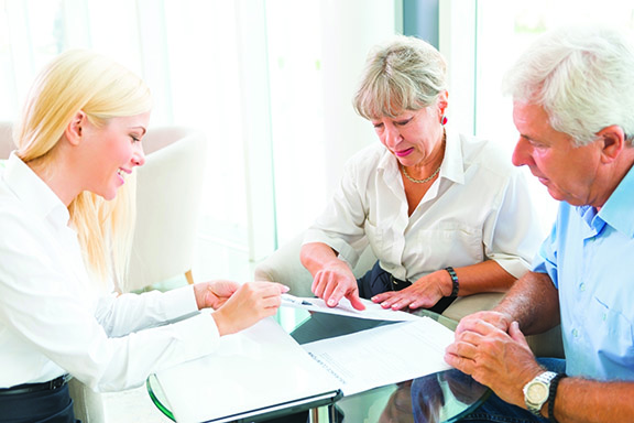 Senior couple read the form for life insurance
